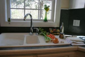 Vegetables next to kitchen sink