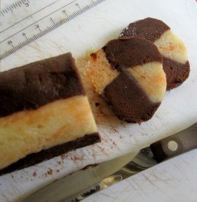 slicing-orange-and-chocolate-cookie-dough-before-baking