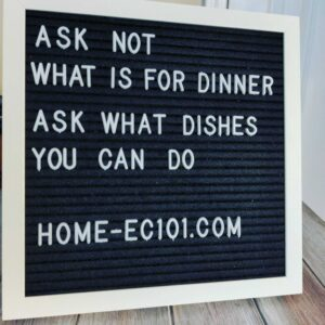 "Text display board with ""Ask not what is for dinner. Ask what dishes you can do,"" attributed to Home-Ec101"